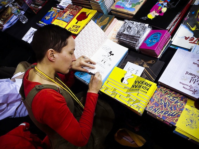 Kaisa Leka signing books at MoCCA Fest (Credit: Photo by Christoffer Leka, courtesy of Kaisa Leka)
