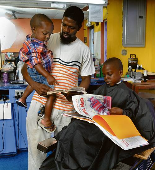 Owner Reggie Ross at Royal Touch Barber Shop (via Book Patrol)