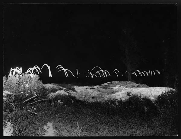 Artillery at night on the Western Front within the Australian lines, circa 1918 (via National Library of Scotland)