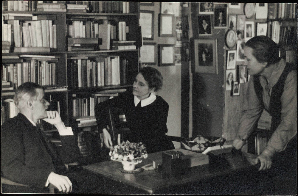 James Joyce with bookseller Sylvia Beach and poet Adrienne Monnier at Shakespeare & Co. in Paris, 1920 (via    Wikipedia   )