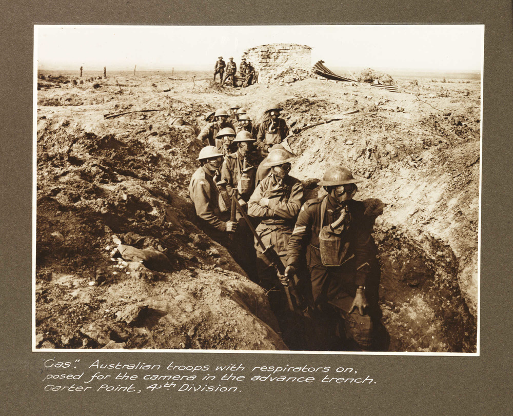 Australian troops with respirators near Becelaere, Belgium, 1918 (via    Flickr   )