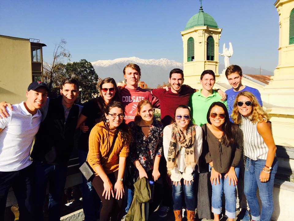 Sage Corps Fellows and their awesome orientation leader, Maggie Edmunds, on the rooftop of Startup Chile