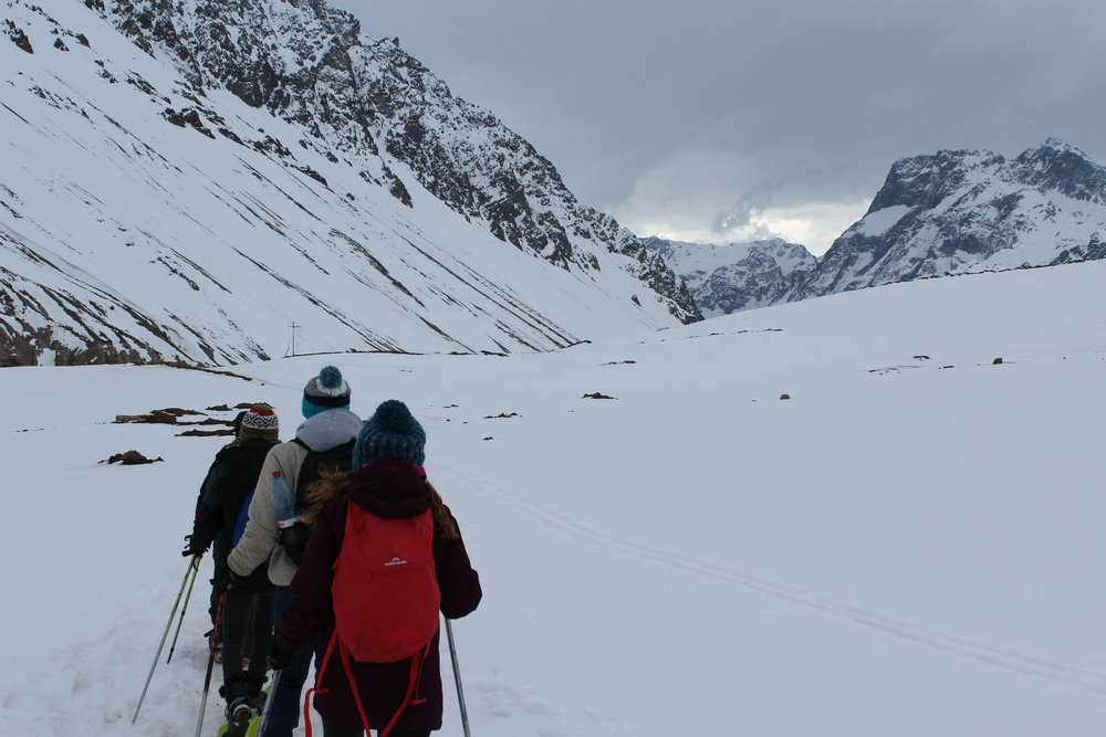 Sage Corps students enjoying a Keteka tour: Snowshoe trekking in the Andes mountains outside of Santiago, Chile