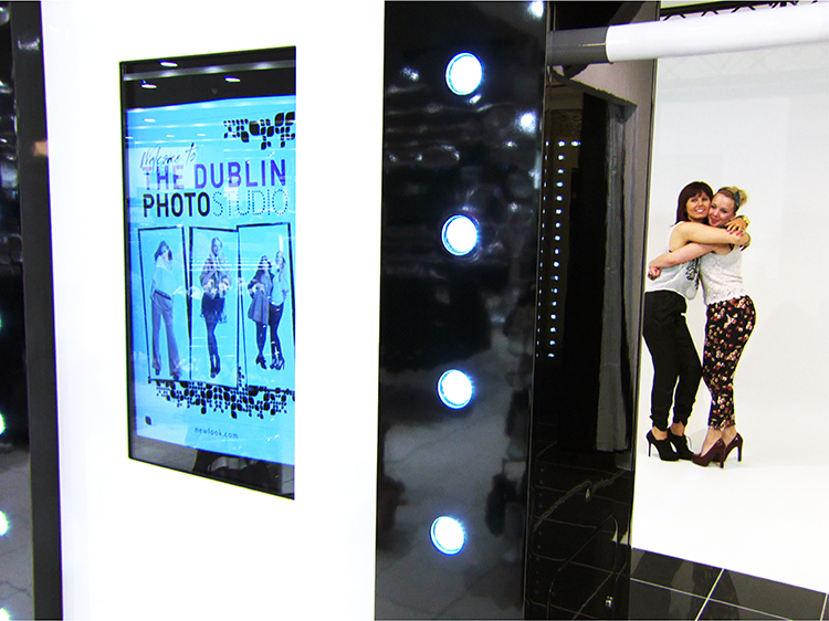 The kiosk has a Studio-facing side which incorporates a touch-screen for users to take their own photo. The reverse faces out into the store and has a screen showing user-generated images dropped into a magazine-style format.