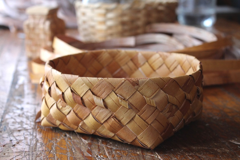 A woven birch bark bread baking basket