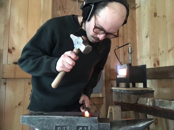 REID WORKS IN HIS NEW SHOP IN NEW HAMPSHIRE