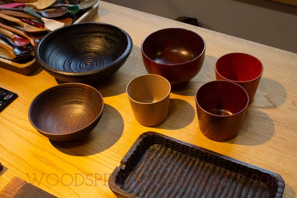Some of Madoka's lacquer work. The rough looking bowl was turned on an old strap powered lathe. The one in front of it I gave to her and it was turned on my foot powered lathe.