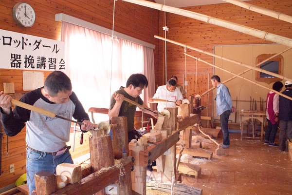 Eager folks turning away. The man second from left is the president of Japan's Green Woodworking Association.