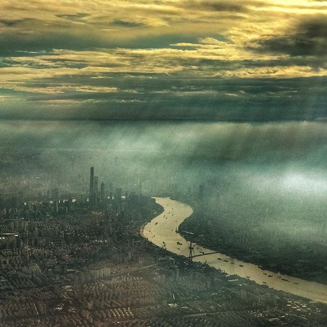 Landing in Shanghai with the pollution very visible at dusk.  The airline lost my luggage so I'm without clothes and bar tools for a bit.