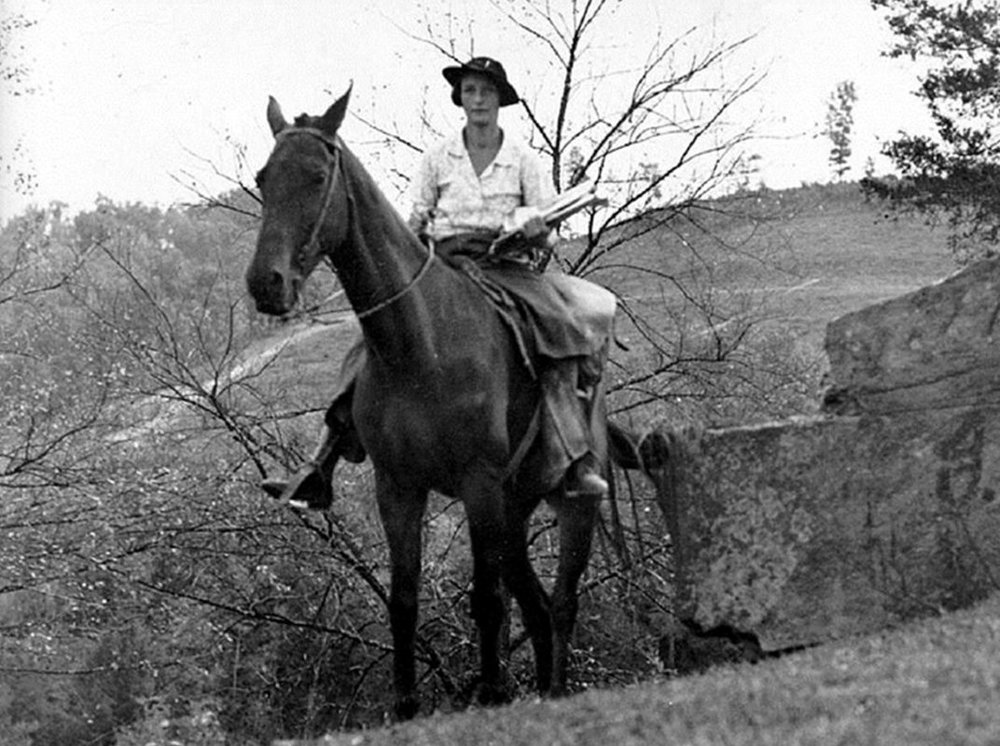 Depression-Era Librarian delivering books by horseback. Because Librarians are badass.