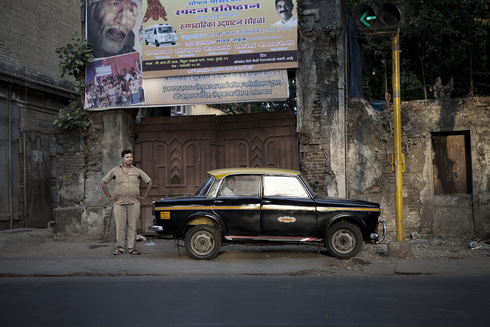 Mumbai Taxi Company is a collection of portraits I took when in India upon completion of a commercial project.  I had a chance to spend two days exploring Mumbai and I found myself fascinated by Mumbai taxis and their drivers.  Traveling the city's endless roads hopping from one taxi to another I was able to create these scenes within moments with natural light and swiftly choreographed directions to the driver and locals in the background.