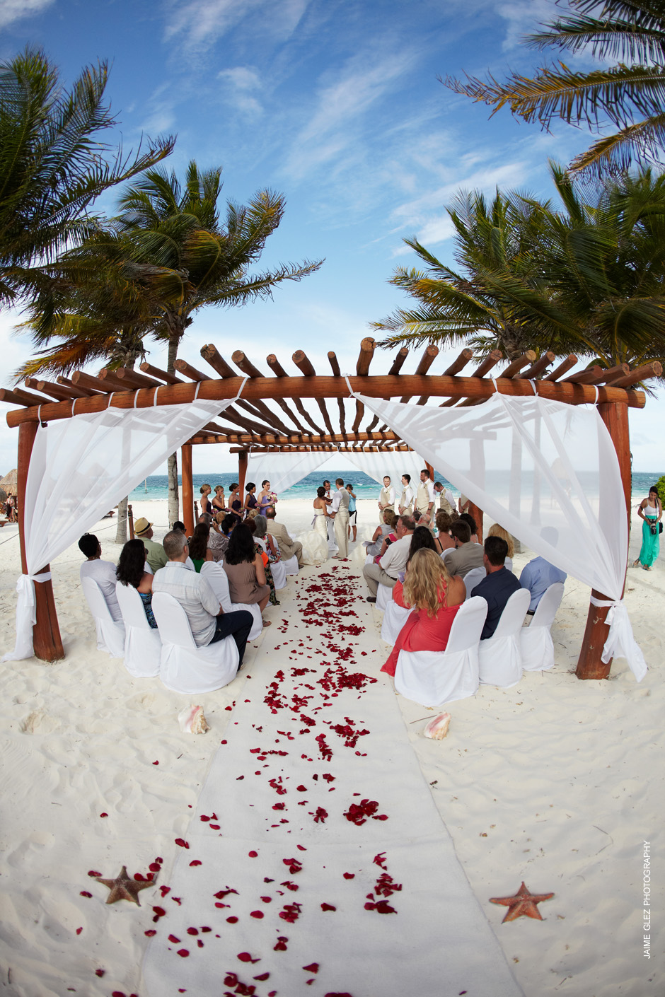 Seaside ceremony for destination wedding at The Excellence Riviera Cancun in Mexico.