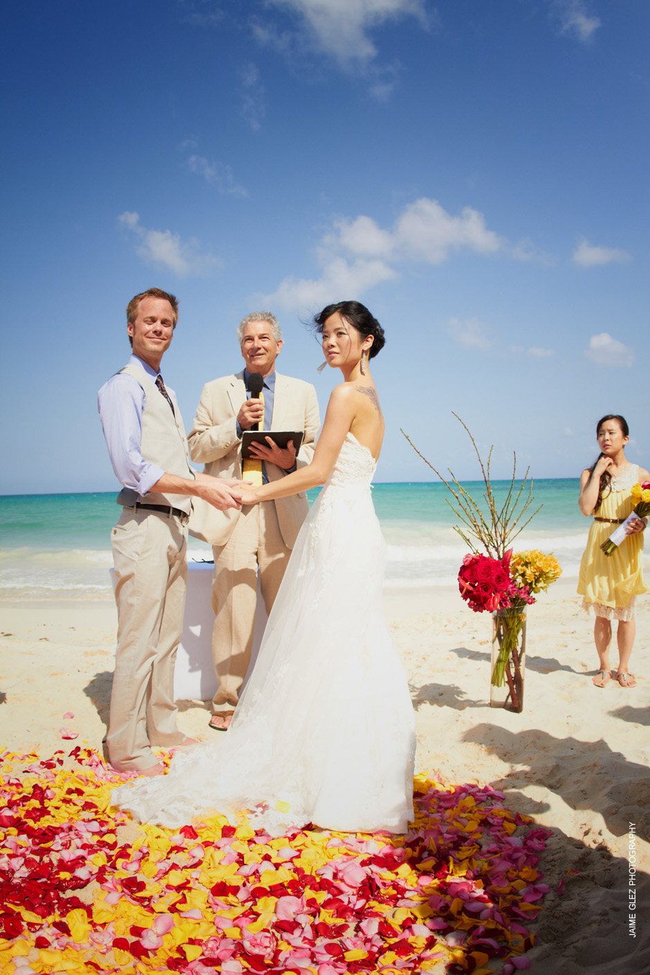 Photographing a stunning tropical wedding in Playa del Carmen, Mexico with a romantic touch of rose petals.