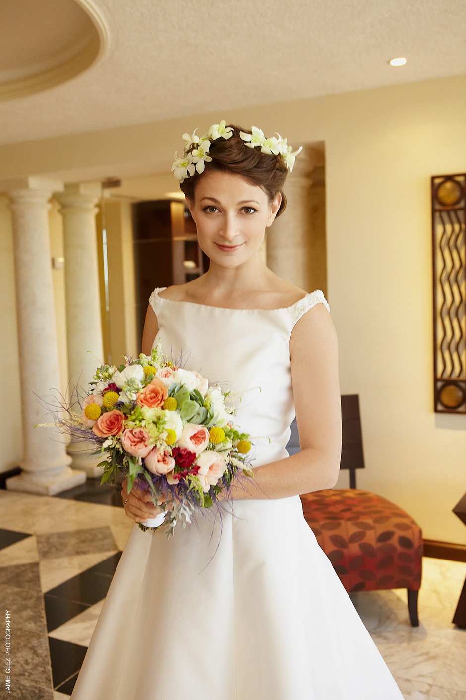Divinely gorgeous and natural bride surrounded by summer flowers.