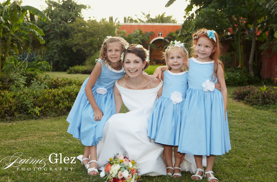 Gorgeous bride and her cute flowergirls.