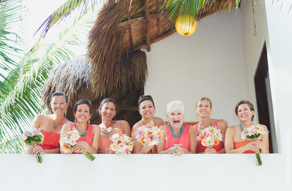 Sweet bridesmaids photography wearing turquoise and coral colors in their outfit.