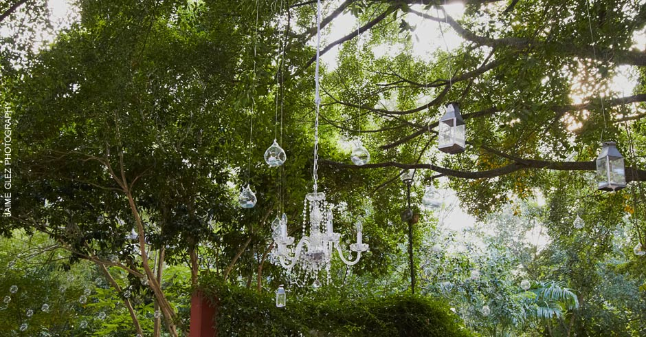Chandeliers and candles are part of the bohemian chic theme of the wedding!
