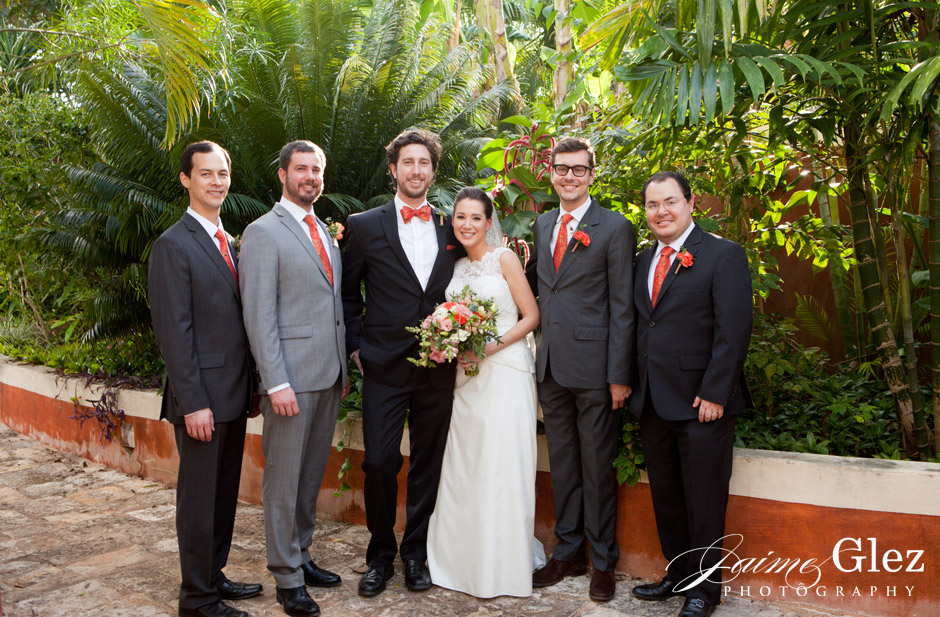 That orange touch in ties and boutonnieres in groomsmen is great!