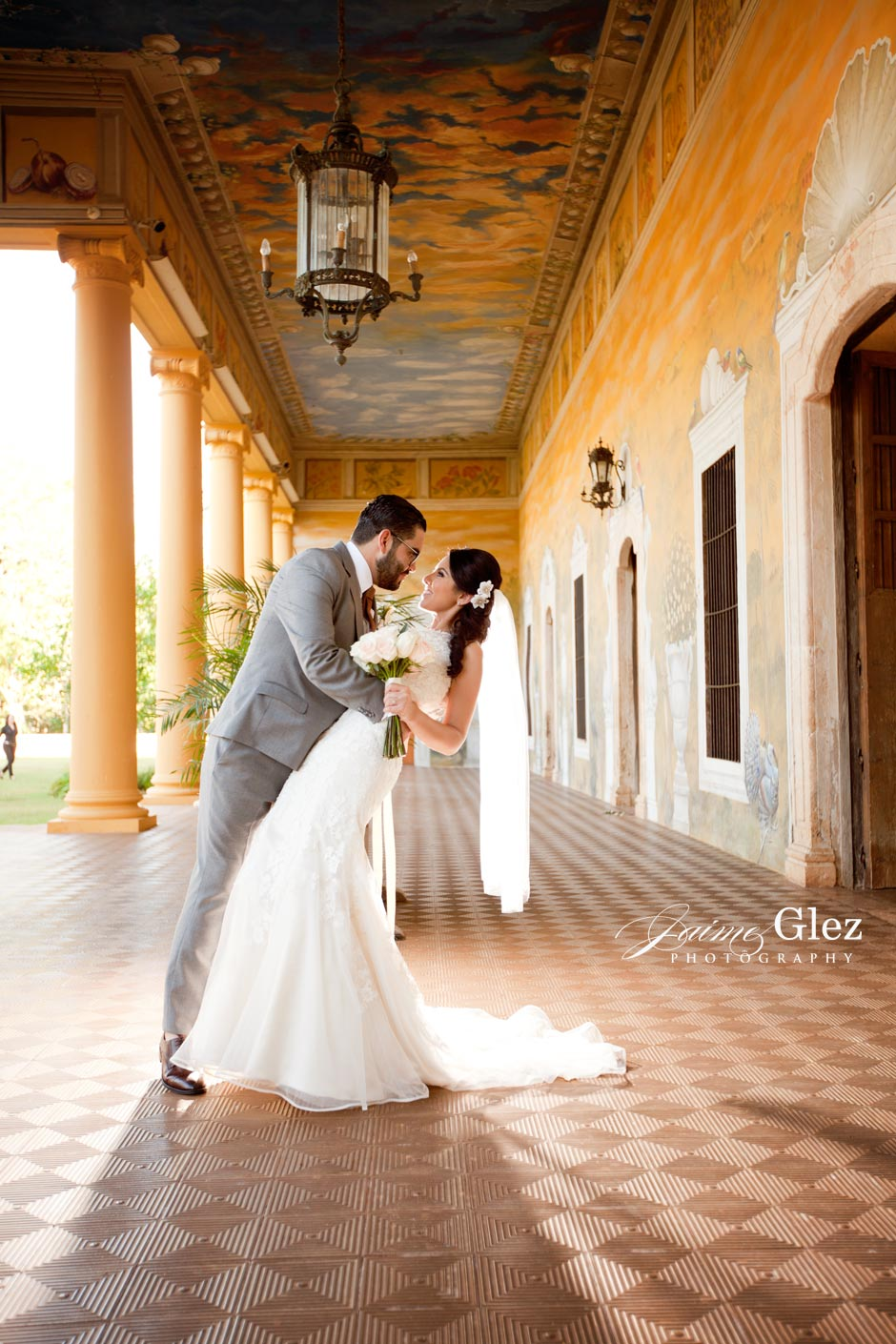 "Lovely bride and groom photo at the ""Casa Principal"" of Hacienda Tekik de Regil."