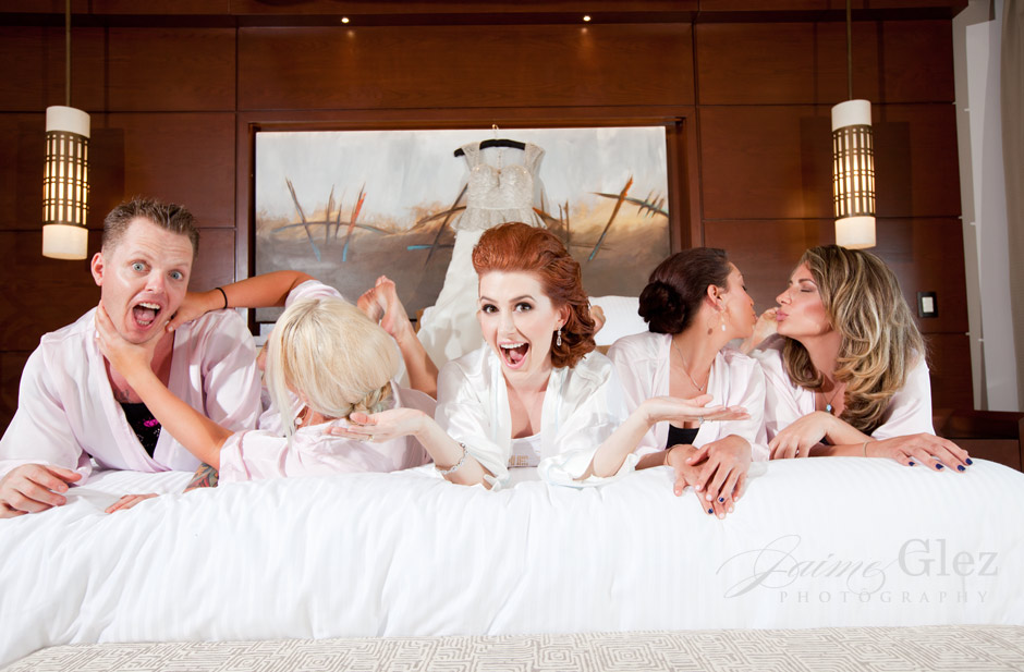having fun with bridesmaids  before the wedding ceremony.