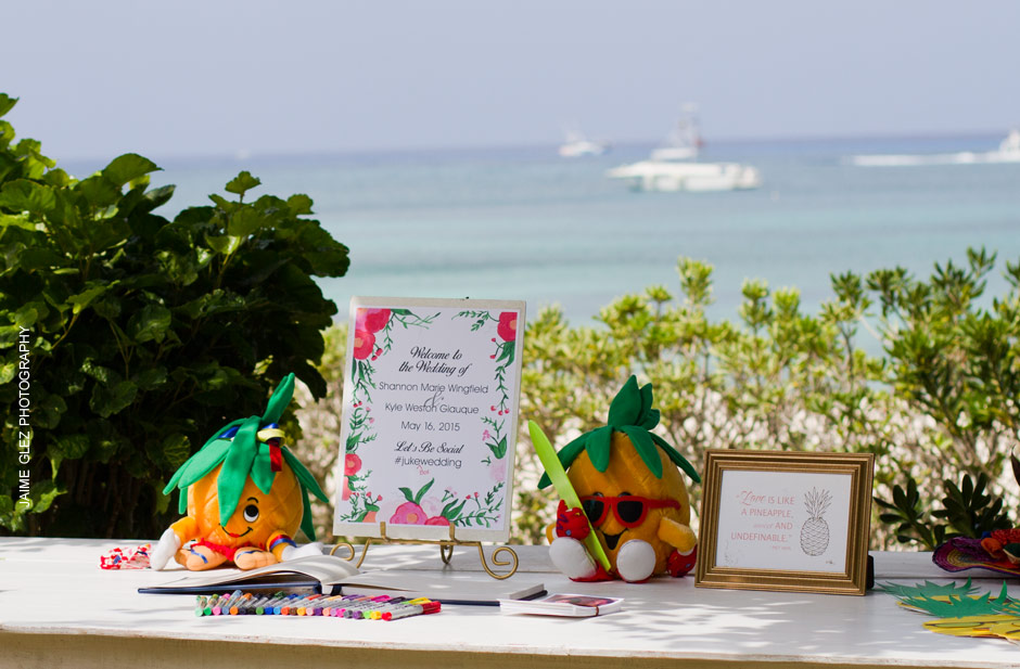 Very cute and tropical pineapples decor for the guest book table.