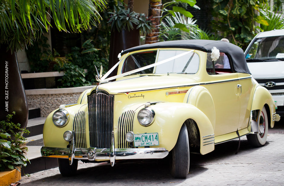 Charming yellow vintage wedding car ideal for the occasion.