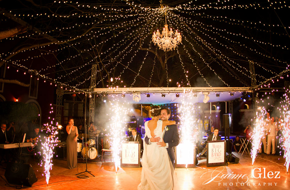 Bride and groom's first dance under romantic crystal chandelier.