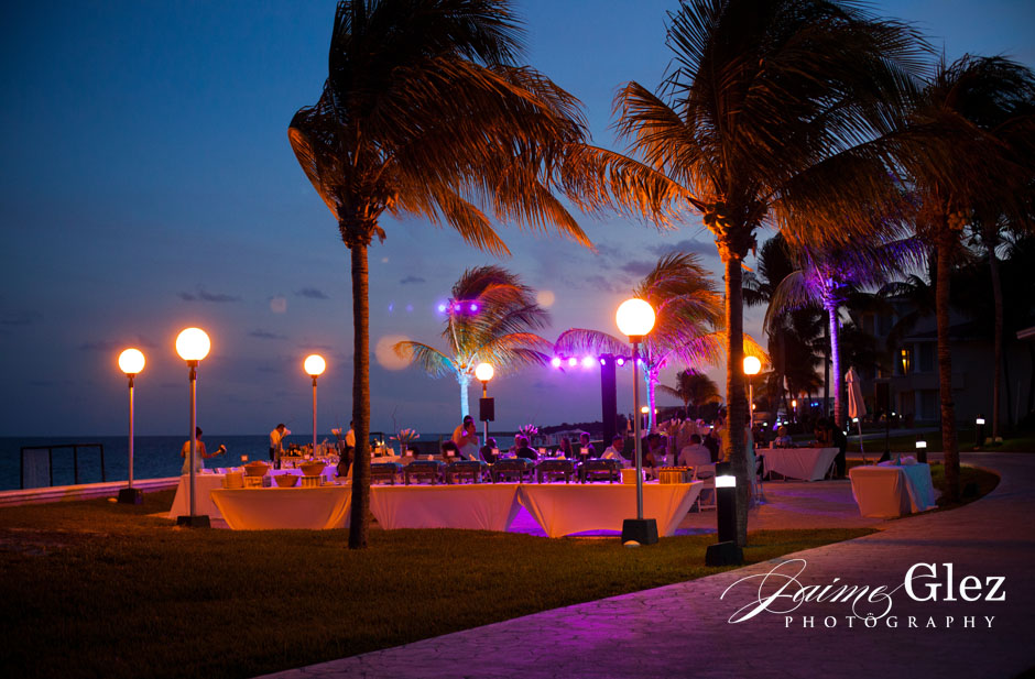 Outdoor wedding reception with ocean view.