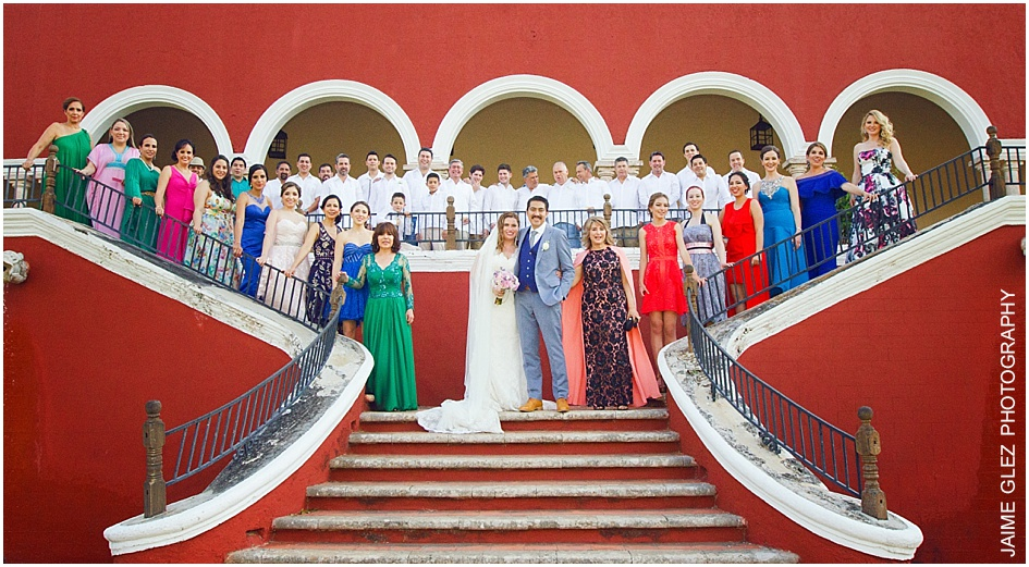 Family photoshoot with bride and groom in the Main House at Hacienda Temozon.