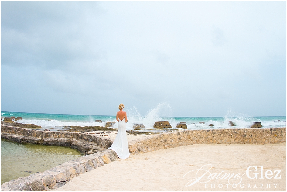 I love this photo! The bride enjoying a great view full of calm during her special day.