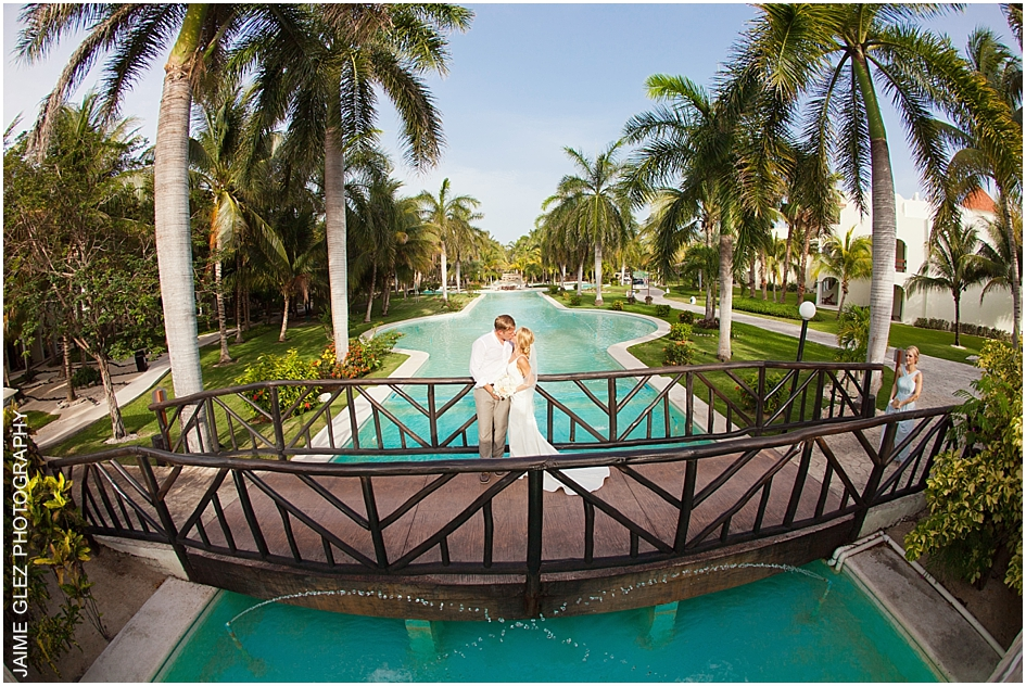 During bride and groom's photo session at El Dorado Royale Resort.