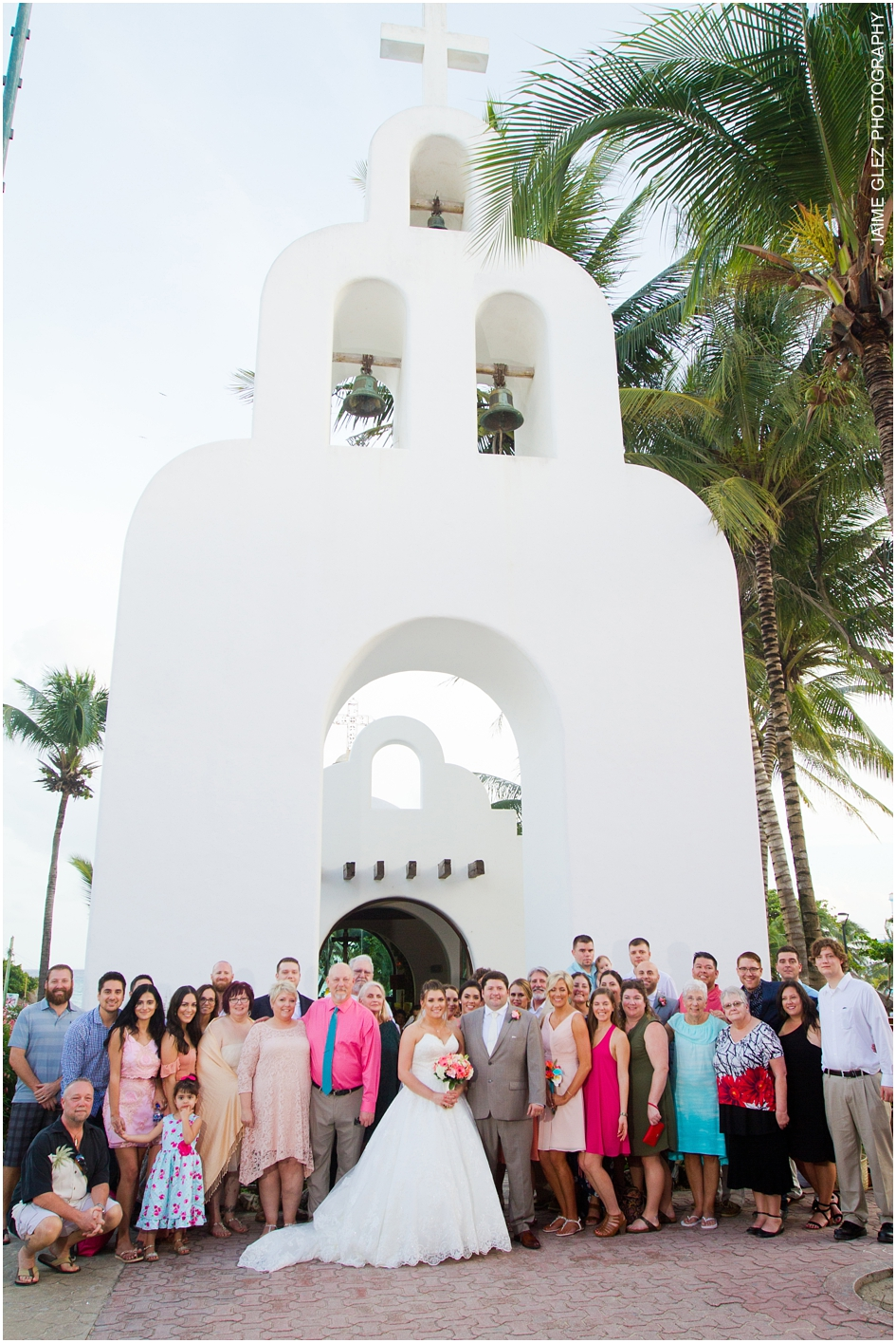 Family and friends after wedding ceremony at Nuestra Señora del Carmen Church in Playa del Carmen.