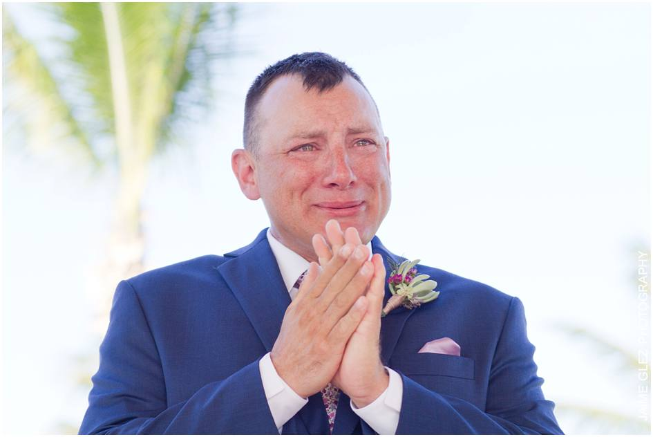 Groom gets emotive when he first sees his beautiful bride.