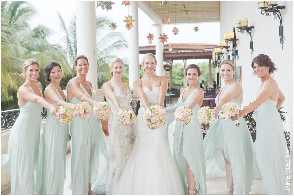 Bridesmaids are gorgeous! Those colors are perfect for a summer wedding.