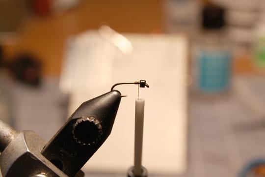 slide a black glass bead on a nymph hook  sz 18 down work best
