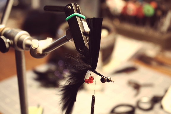 rotate the hook and attach a piece of black swiss straw to the bottom of the shank.