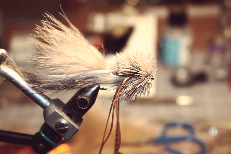 fill in the rest of the head to the hook eye. keep it loose don't pack the clumps like you would a popper.