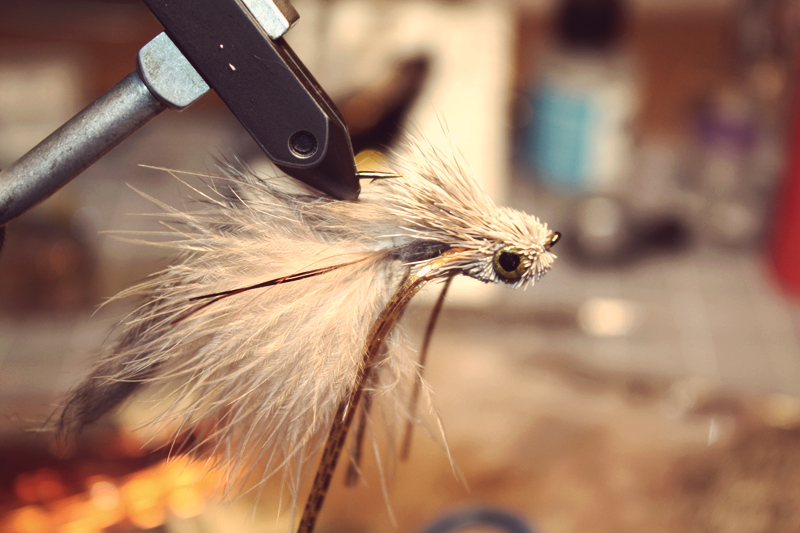trim the head flat on the bottom and diver style on the top.