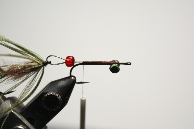 mount another hook tie in some dumbbell eyes and attach the back portion of the fly with some wire. it's a short articulation so the bead is only there for flashes of red in the middle.