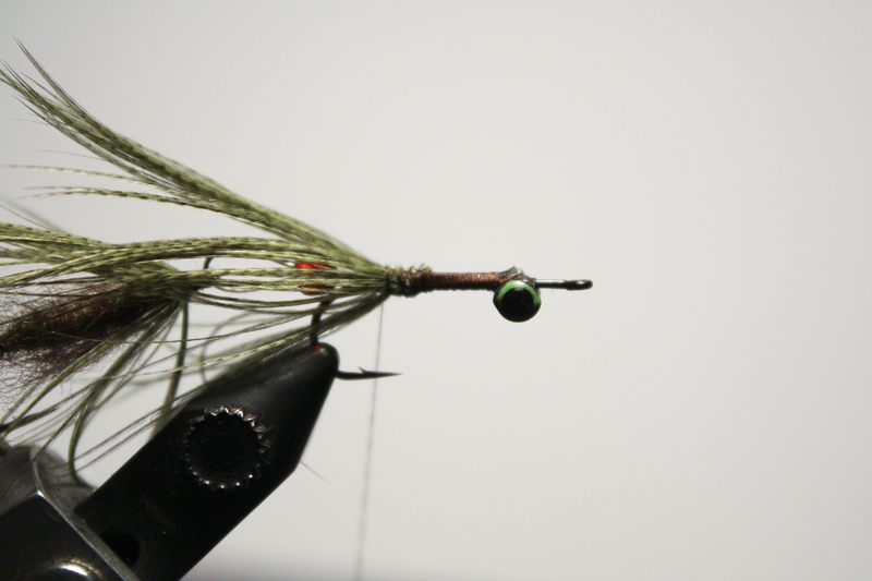 use the remainder of the mallard flank to make a couple turns at the rear of the hook to help blend it all together.