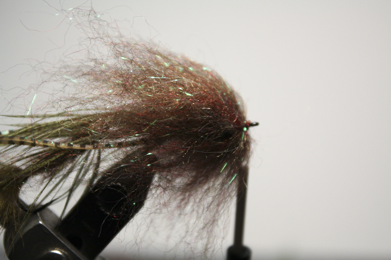 tie in smaller and shorter fibered clumps in a similar fashion until you reach the hook eye. should take about 6 clumps to build the entire head portion.