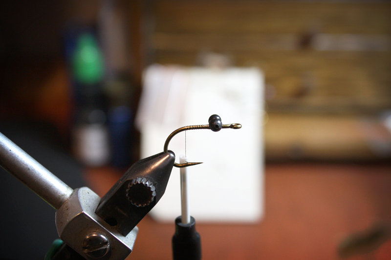 mount your bead chain eyes securely to the top of the shank about a hook eye length behind the eye. end with your thread in line with the hook barb.