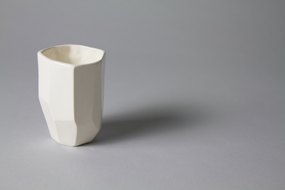 Designed to be clean and simple, the Vasa cup is a slip cast form that was hand crafted from a faceted solid wood form.
