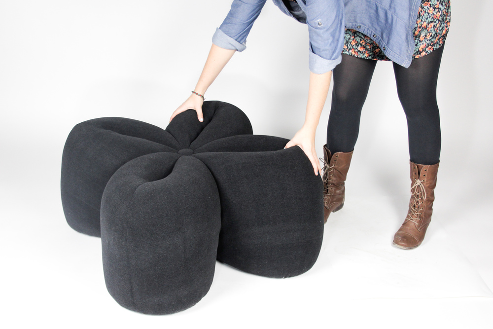 The Clover Pouf is easy to move around because it is so light.