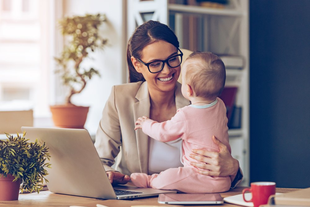 Business woman with baby on laptop at home-min.jpg