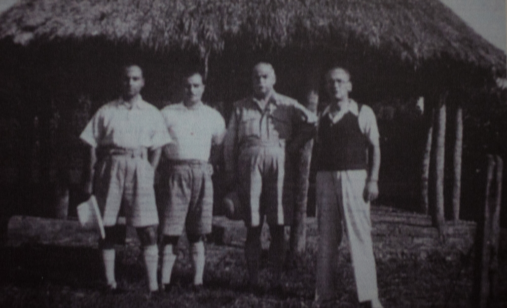 Three of the Maltese internees, Formosa, Ganado and Cossai, together with Enrico Mizzi in front of the internment camp at Uganda