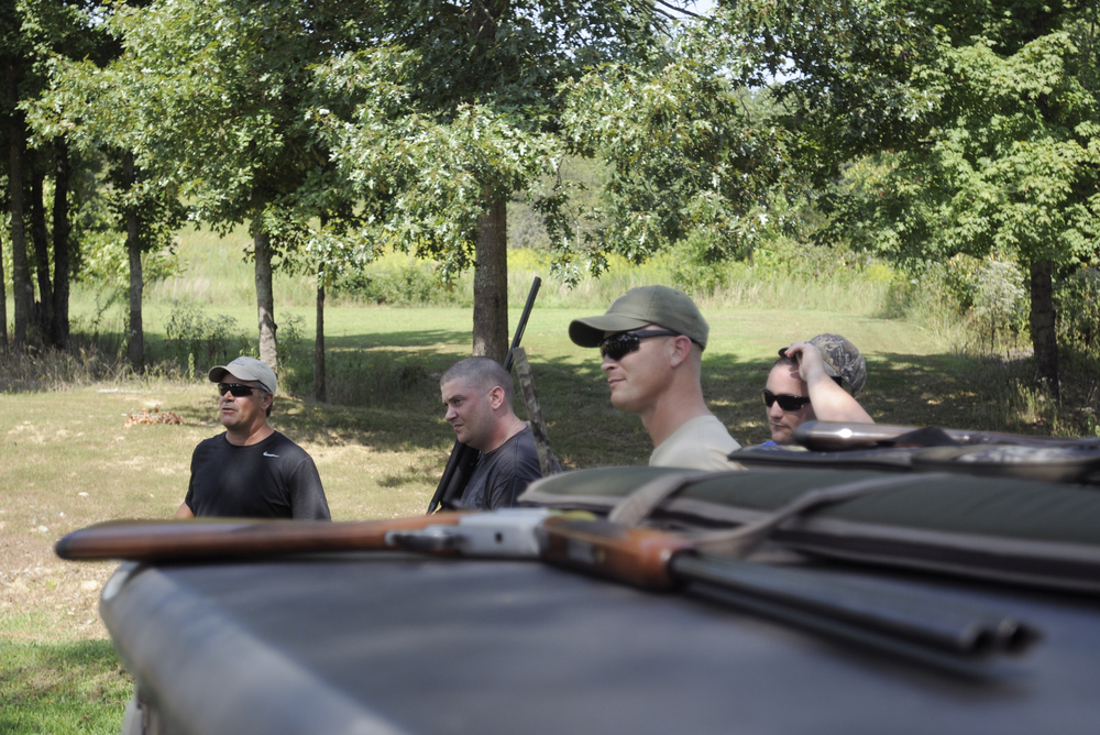 Members of a dove hunting party formed in part with the Healing Outside Of A Hospital, HOOAH, Program from Ft. Campbell swap stories before reviewing gun safety procedures.