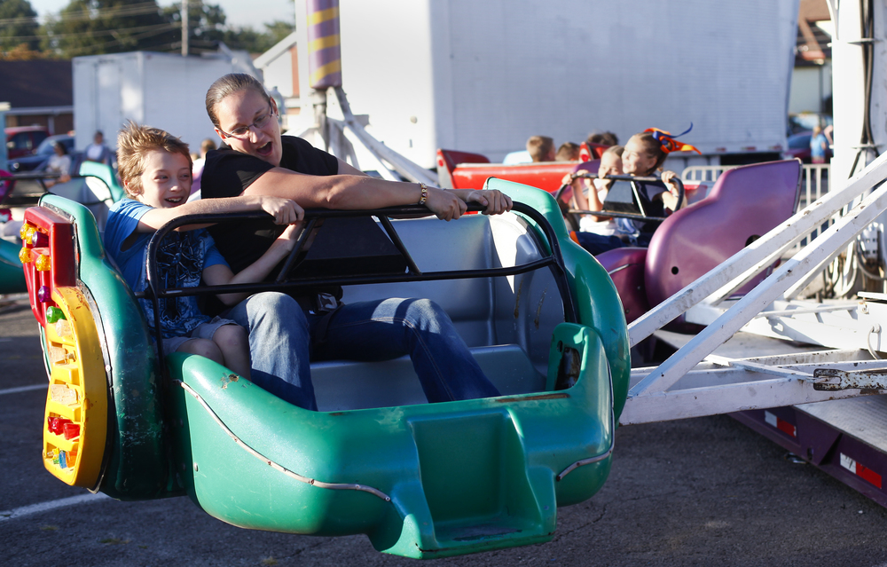 Nathaniel Morrow, 9, and Jessica Klemens ride the Sizzler on Friday, September 13, during the Corn Festival.