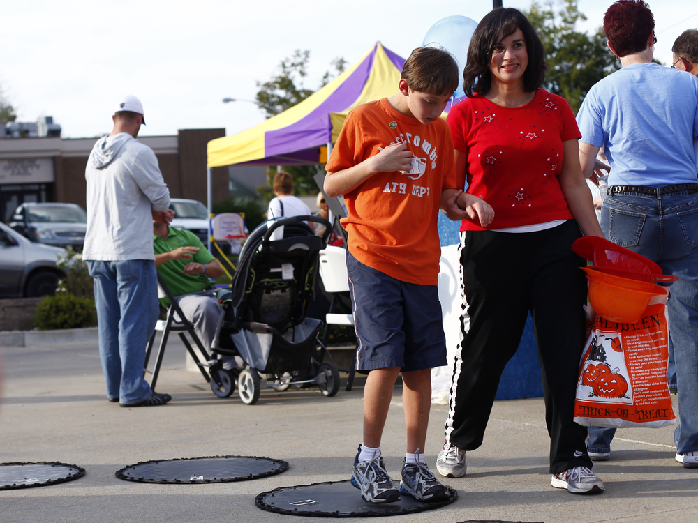 Joseph Dauwe, 9 of Morganfield, and his mother, Jackie, participate in a cake walk at Family Fun Night held at the Union County Public Library's Morganfield branch. The event is in its second year and serves as a place for community members to interact and become acquainted with the library.