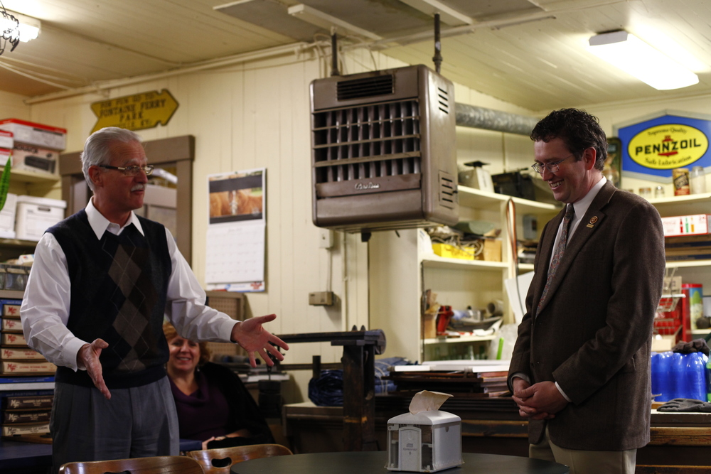 Congressman Thomas Massie, right, is introduced by State Senator Ernie Harris as the Goshen General Store. Massie was conducting a listening tour around his district in which he updated constituents on what he has been doing and fielded questions.